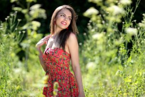 Smiling Woman In Pink Black And Green Floral Tube Dress