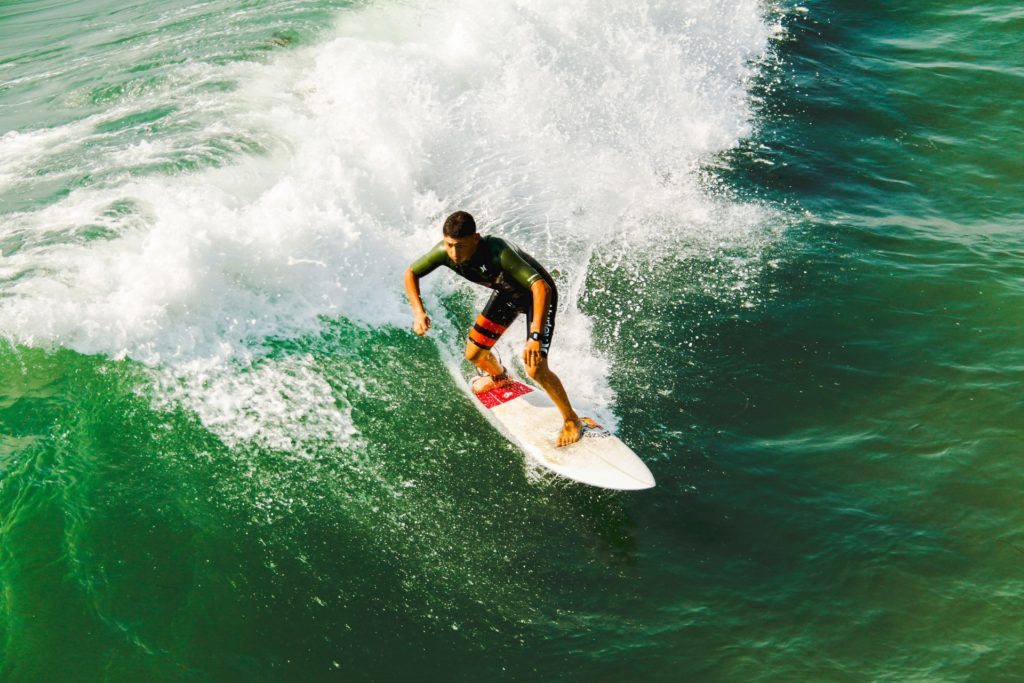 Man Playing White Surfboard
